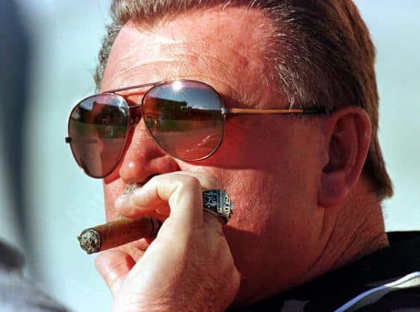 Dick Butkus smoking a cigar
