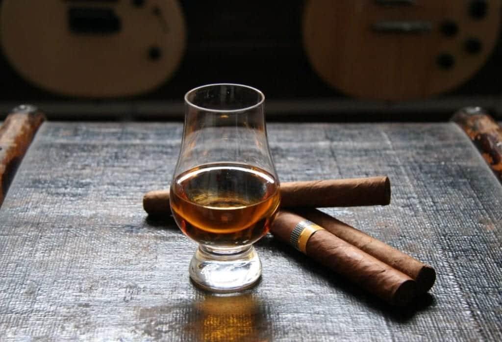 giving cigar taste of alcohol